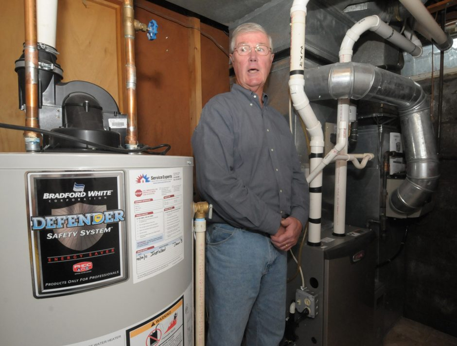 On Monday morning, Thomas Doody of East Bayberry Rd. in Glenmont, talks about how he has replaced his heating system and water heater with energy efficient units over the summer, which have given the family a cost savings by installing. Executives from Na