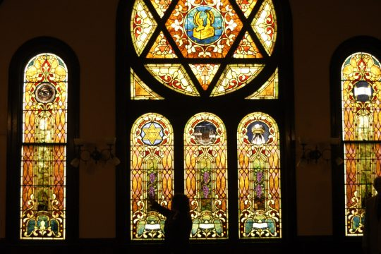 Pastor Istar Hernandez, center, shows the newly cleaned original stained-glass windows in Templo Esperanza de Israel on Mohawk Place in Amsterdam Friday. The temple will celebrate its grand re-opening and dedication Saturday. At right is Hernandez's