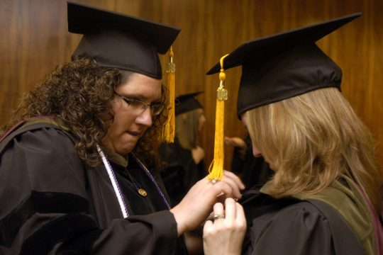 Albany College of Pharmacy graduates Terri Underhill, left, of Stetson, Maine, and Jennifer Timpani of Rochester prepare for commencement exercises at the Empire State Plaza on Sunday.