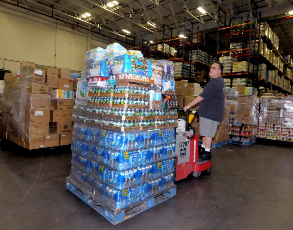 Price Chopper warehouse worker Peter DiCaprio moves pallets of water and food to a tractor trailer that will be shipped to a local Price Chopper store.