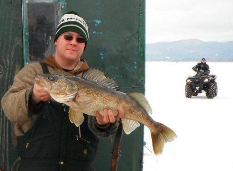 Ira Cromley III of Mayfield displays the five-plus-pound walleye he pulled through the ice late last month on The Great Sacandaga Lake near Broadalbin.