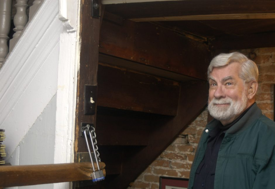 Ghosthunter and author David Pitkin stands in the stairway to the Glen Sanders Mansion wine cellar in this 2008 photo.