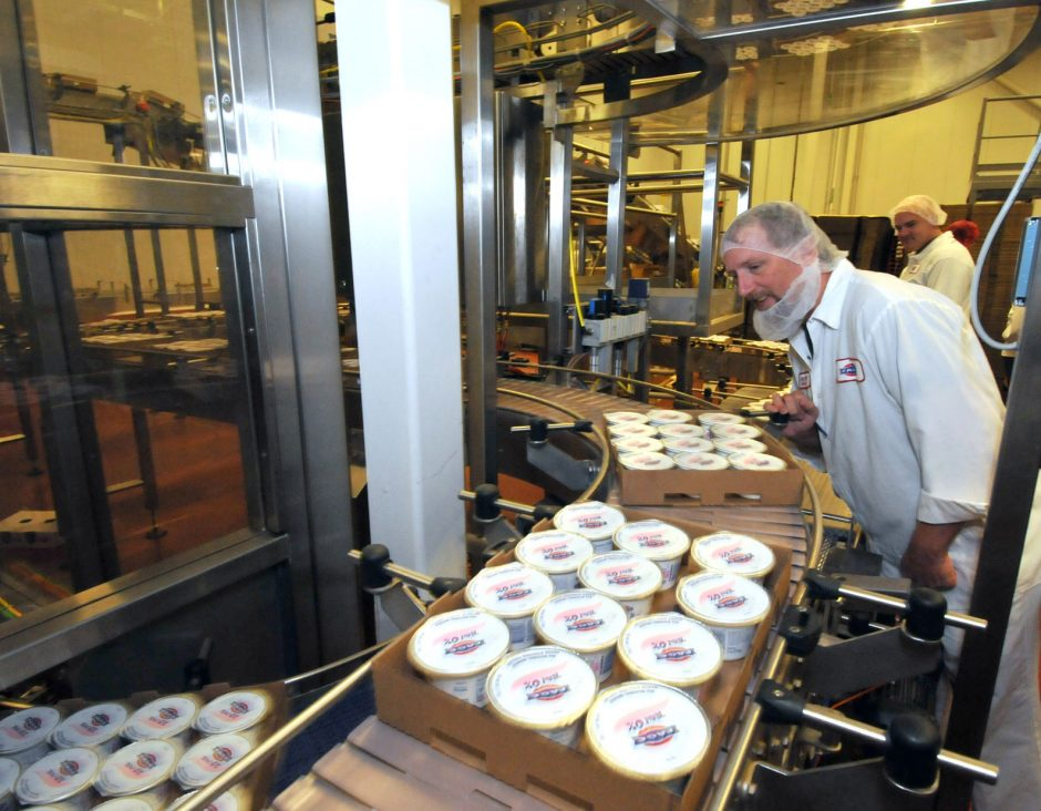 Production supervisor Anthony Valovic watches for quality control as Fage Greek-style yogurt is packed into cases at the Fage USA Dairy plant in Johnstown.