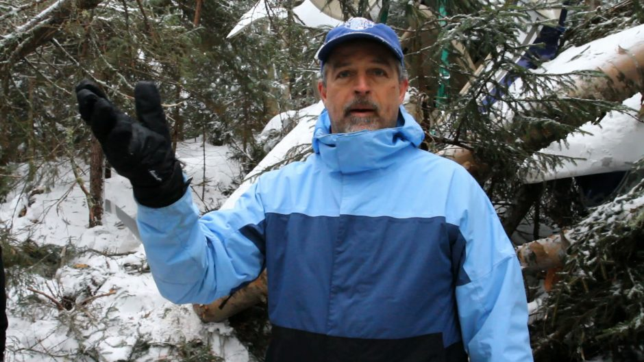 Pilot Frank Dombroski, from Westfield, N.J., talks about a Feb. 21, 2013 plane crash at the impact site near Lake Placid. (AP Photo/Adirondack Daily Enterprise, Mike Lynch)