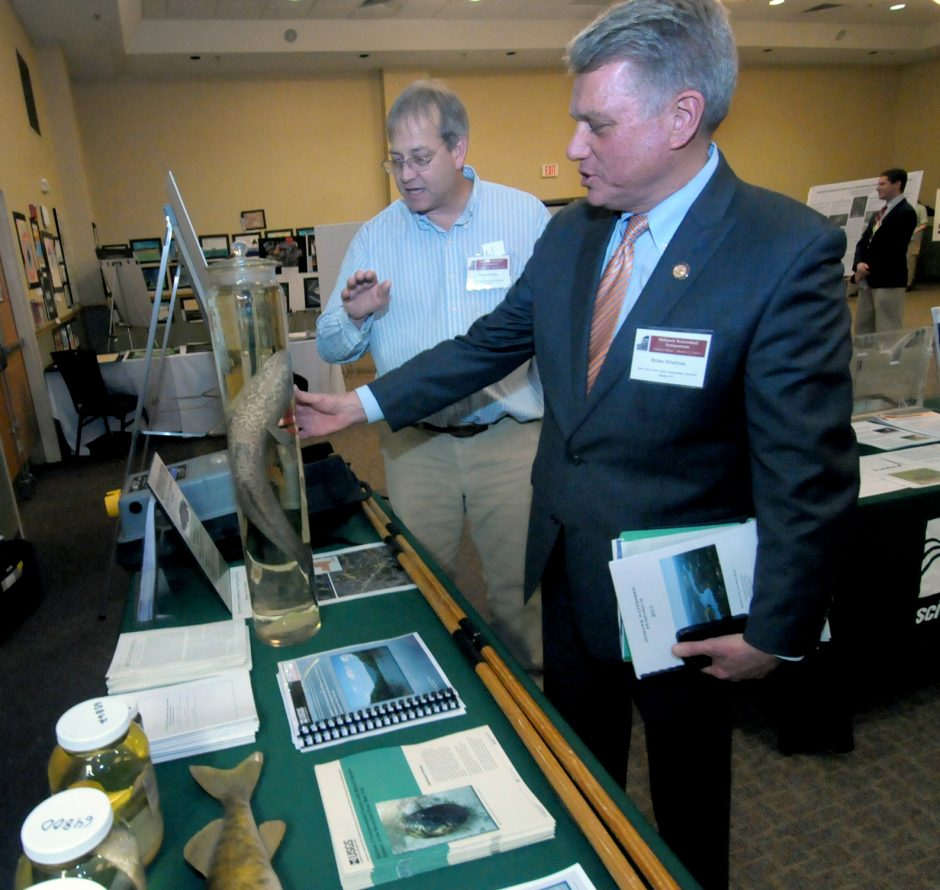 The annual Mohawk Watershed Symposium was held on Friday at College Park Hall at Union College.  Peter deVries, left, of the USGS talks with Brian U. Stratton,Director of the New York State Canal Corporation, about the unwanted Northern Snakehead distribu