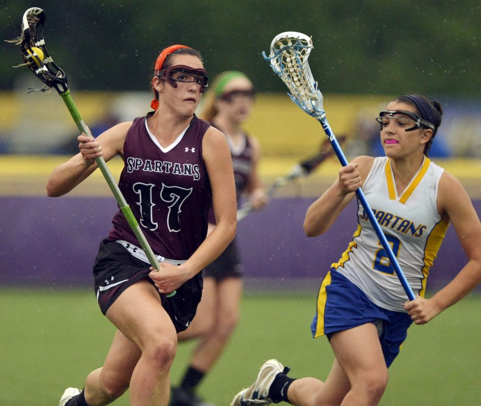Amy LeBel of Burnt Hills-Ballston Lake, moves up field past Queensbury's Lindsey White in the Class B Championship game at UAlbany Thursday.