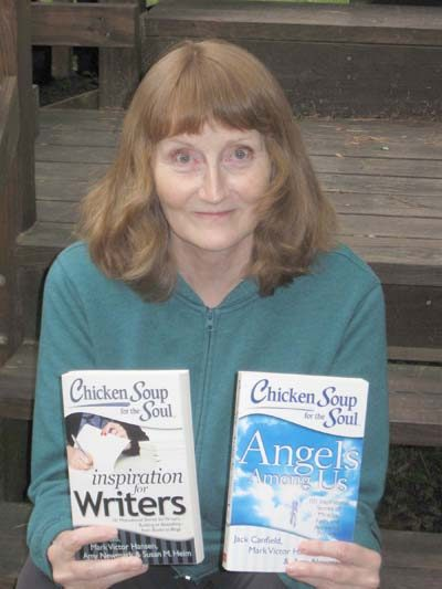 Local author Wendy Hobday Haugh holds two books in which her essays have been featured.