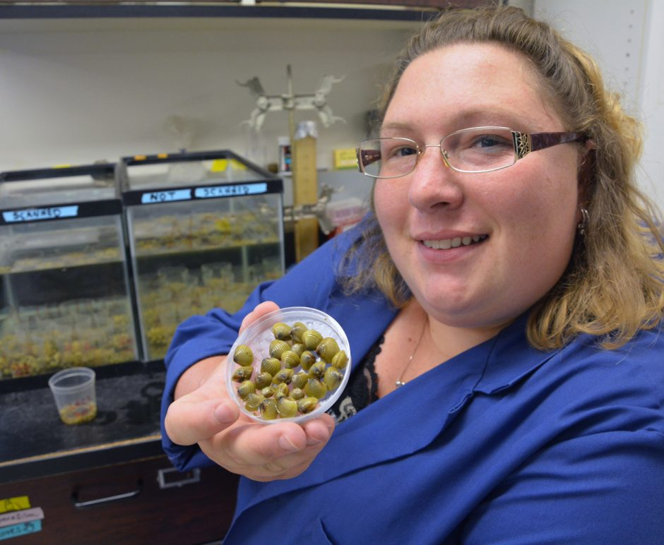 Darrin Fresh Water Institute Research Assistant, Tiffiny Burlingame (cq) shows a dish of Asia Clams that are a new invasive speicies in Lake George.