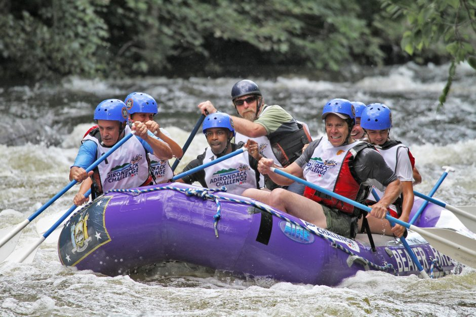 Gov. Andrew Cuomo and staff members navigate rapids on the Indian River on Sunday.