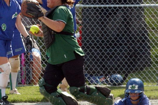 Shenendehowa catcher Emilia Peluso looks for an out after Cicero-North Syracuse's Lindsay Flanagan scores on a single in the third inning of Wednesday's regional game in Queensbury.