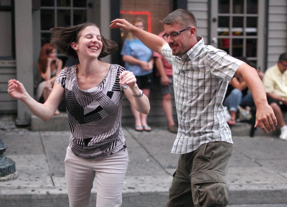 Dana Wilhite, of Watervliet, and Jason Hosier, of Rotterdam, dance to the El Dorados on Caroline Street in during the Final Stretch Music Festival in Saratoga Saturday, August 31, 2013.