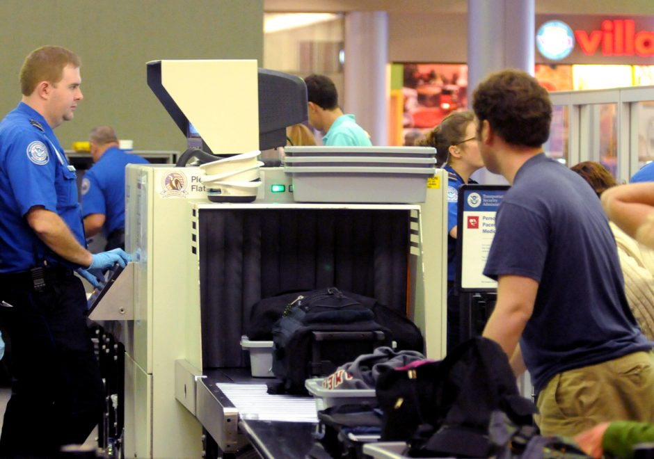 Passengers and baggage are screened by the TSA at the Albany International Airport around the 2012 Thanksgiving holiday.