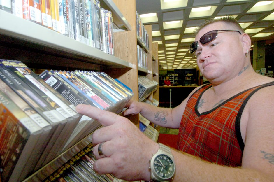 One way that Shawn Dell saves money is to borrow DVD movies at the Schenectady County Library in Schenectady.