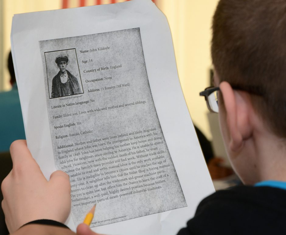 Martin Luther King School eighth grader, Jacob Cafarella, carefully reads over a biography of Irish immigrant, John Kildoyle, 14, that migrated to Schenectady in 1849 to work at the American Locomotive Company (ALCO). The students each presented a hist...