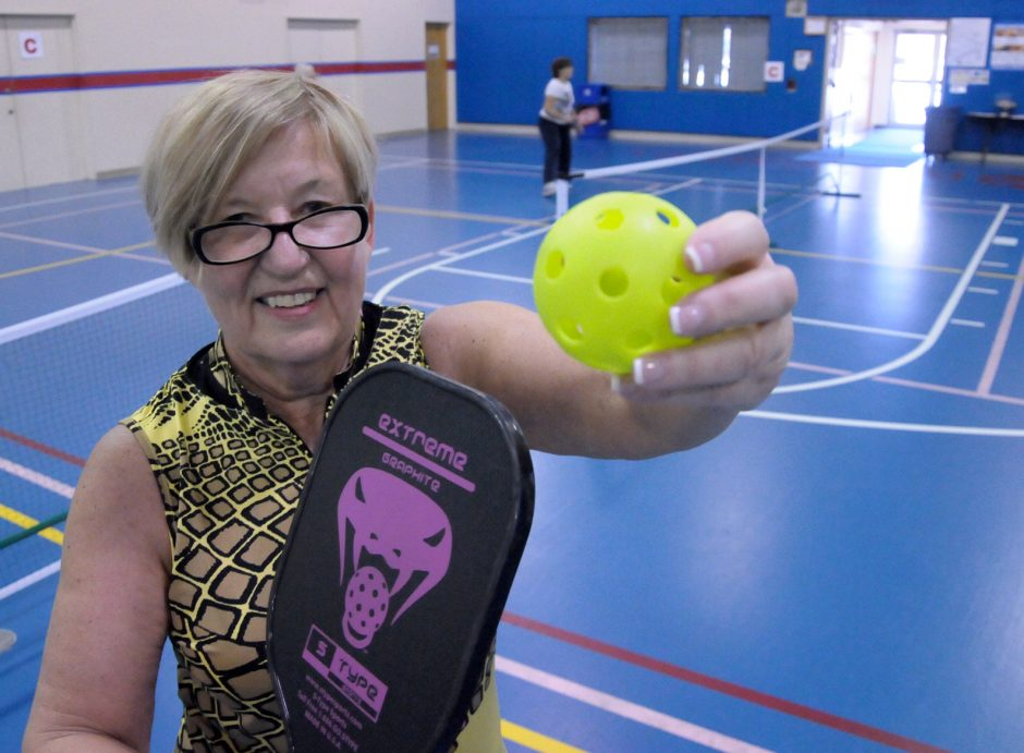 Diane Benton enjoys spending her Monday mornings playing pickleball at the Wilton Recreation Center at Gavin Park. The game is played with a hard paddle and polymer wiffle ball. Pickleballs typically move at one third of the speed of a tennis ball.
