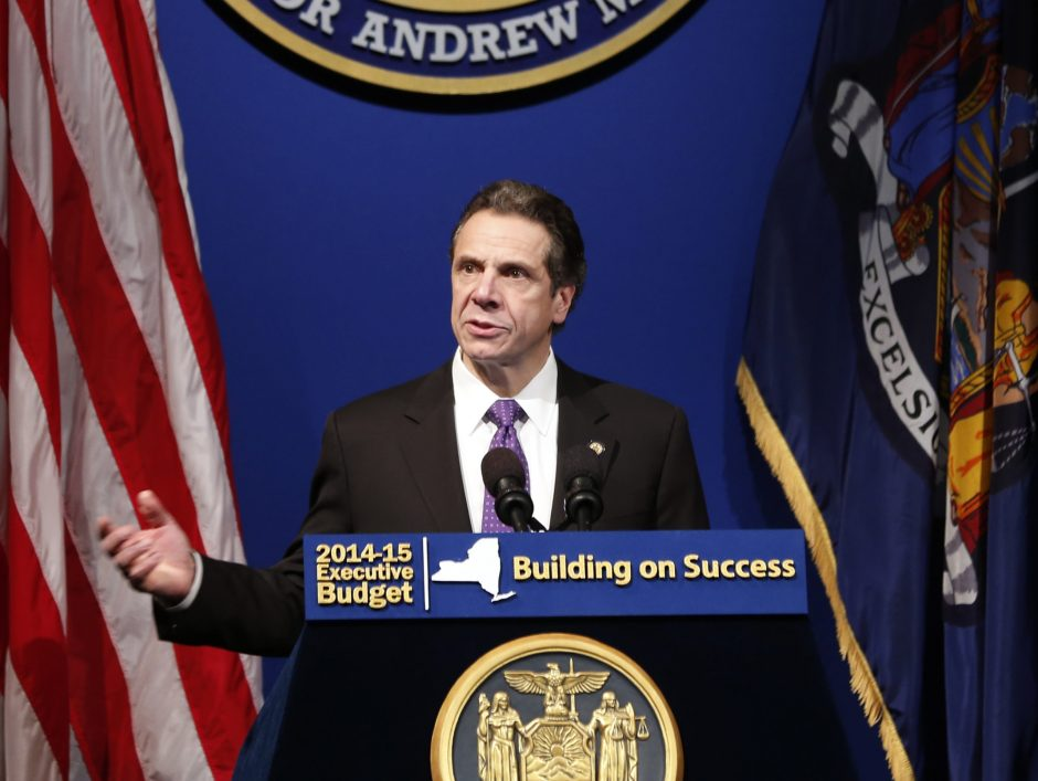 New York Gov. Andrew Cuomo presents his 2014-15 executive budget proposal at the Hart Theatre on Tuesday, Jan. 21, 2014, in Albany, N.Y.