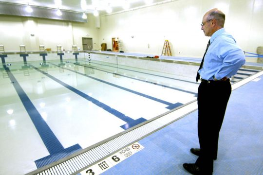 Fulton County YMCA Chief Executive Officer Steve Serge looks over the Fanch Family Pool on Wednesday. Serge says that he expects the facility will be completed by Labor Day.