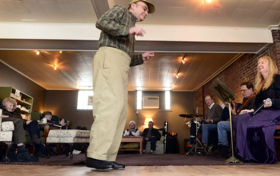 Arthur's Market proprieter Richard Genest tap dances to a song at the grand re-opening of the market on North Ferry Street in Schenectady's Stockade district on Sunday.
