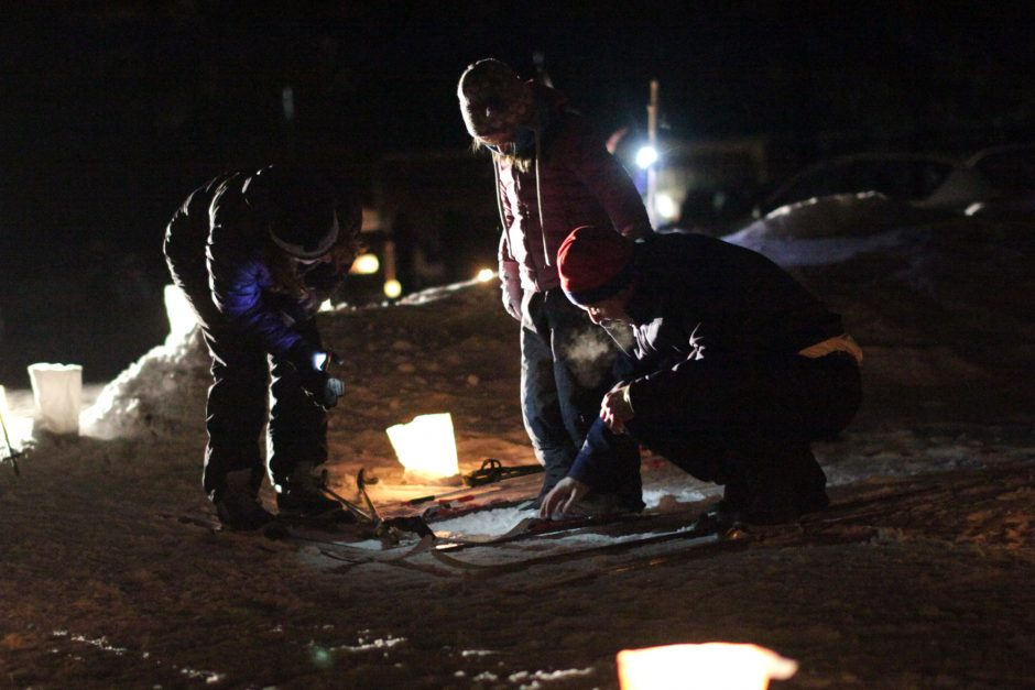Matt and Kathy Lindley, of Wilton, help their 8 year old daughter Kate attach her skis before taking to the trails at Saratoga Spa State Park during the Winter Fest Candlelight Ski and Snowshoe on Friday, January 31, 2014.