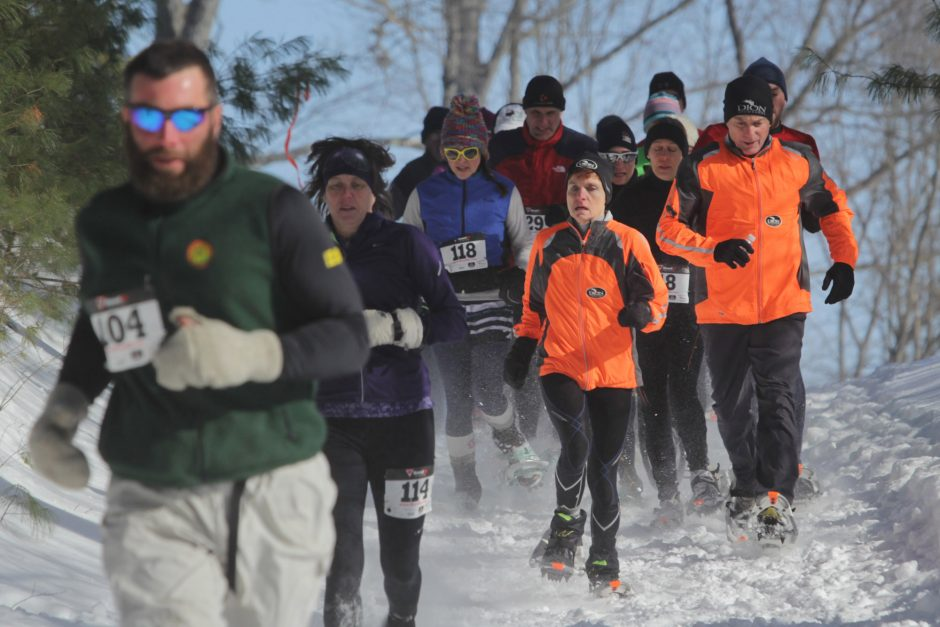 Snowshoers compete in the 11th Annual 8K Snowshoe Race at the Wilton Wildlife Preserve & Park on Saturday, February 8, 2014.