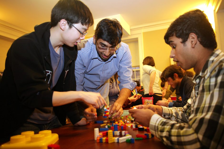 Wayne Fu, a junior biology economics major from Toronto, left, Mihir Patel, a sophomore biology economics major from Nashville, center, and Krishna Pakuri, a sophomore, right, build a cell nucleus during a LEGO building competition hosted by the Biolog...