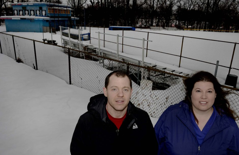 Ryan Pezzano of West Side Little League, left, and Sara Siddons of Schenectady Little League, stand on a mound of snow with the Schenectady Little League field in the background at the corner of Rutger Street and Michigan Avenue last week.