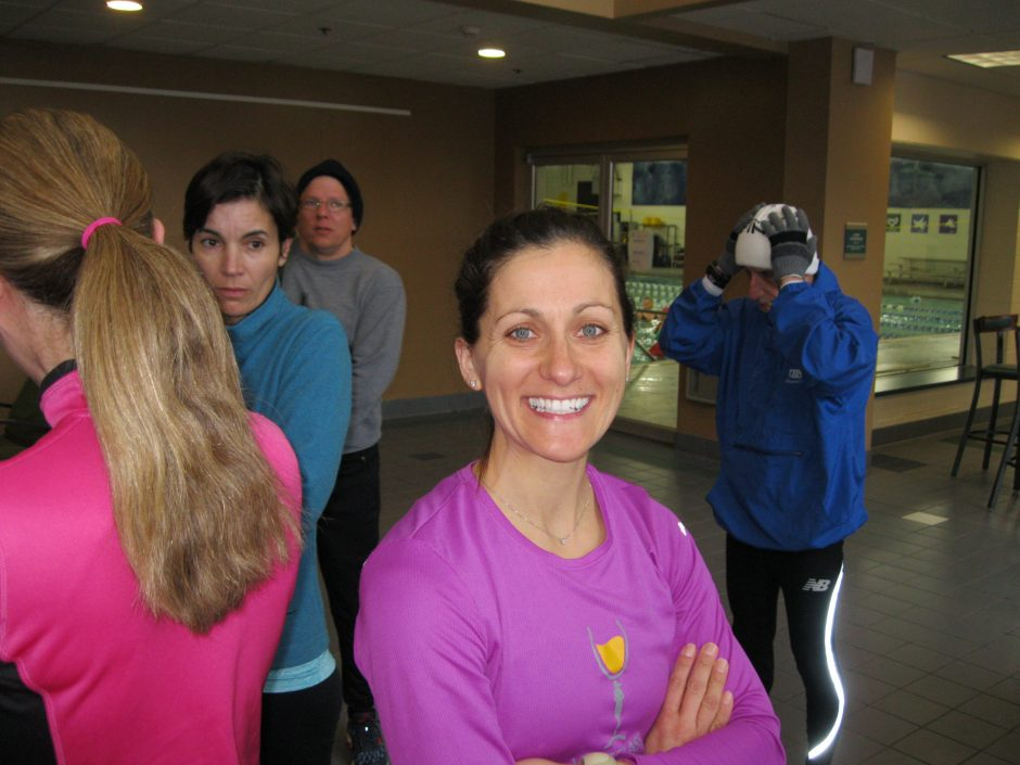 Ballston Lake's Danielle Maslowsky prepares to lead a small group of athletes at the Clifton Park YMCA on a training run.