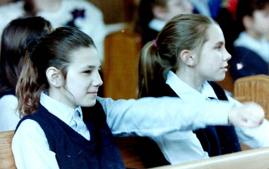 Fifth-graders Darla Coppola and Erica Besenval listen to a spring lecture at the Immaculate Conception School on Bradt Street in Schenectady.