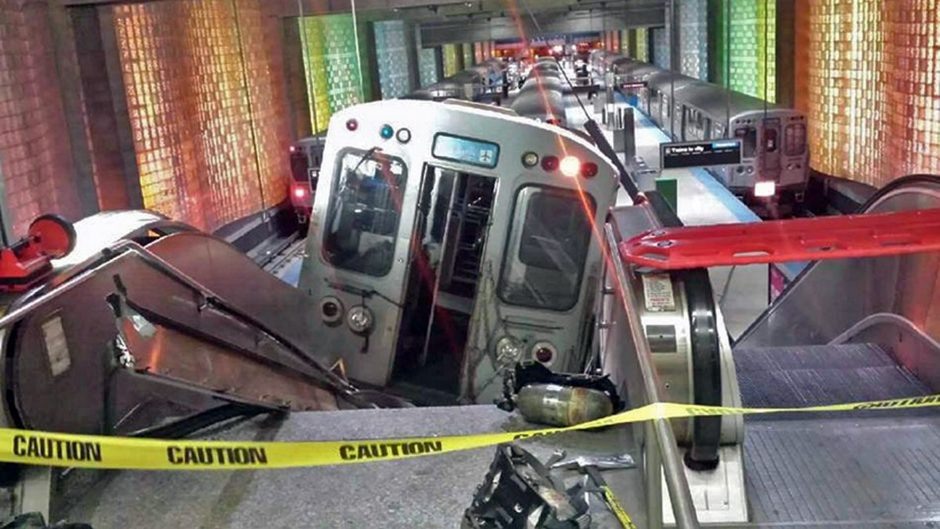 "A Chicago Transit Authority train car rests on an escalator at the O'Hare Airport station after it derailed early Monday, March 24, 2014, in Chicago. More than 30 people were injured after the train ""climbed over the last stop, jumped up on the sidewal..."