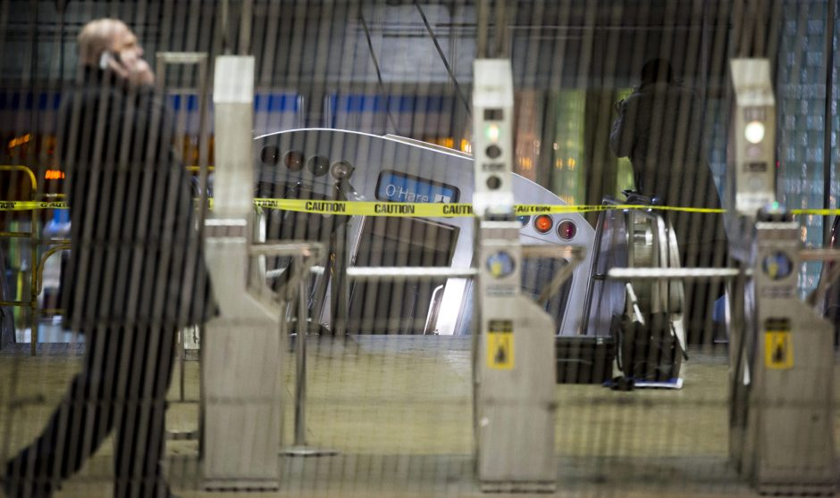 A Chicago Transit Authority train car rests on an escalator at the O'Hare Airport station after it derailed, injuring more than 30 people, in Chicago. Had the crash occurred during the day, when the trains are often full and the escalator packed with l...