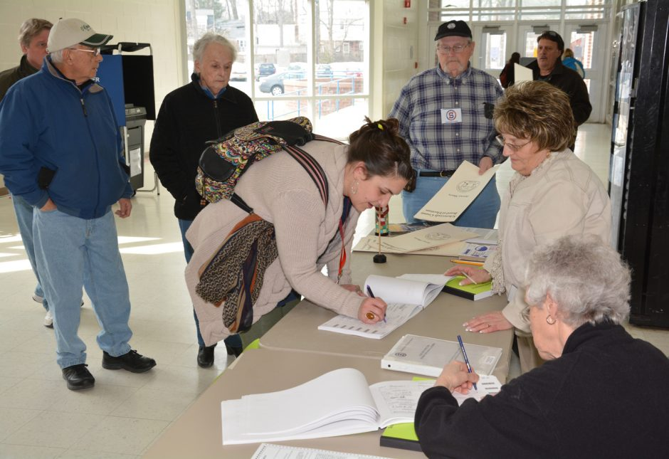 Election inspectors Janet Linkinhoker, left, and Rosalee Nappi get voters signed in at Schenectady High School on Tuesday afternoon.