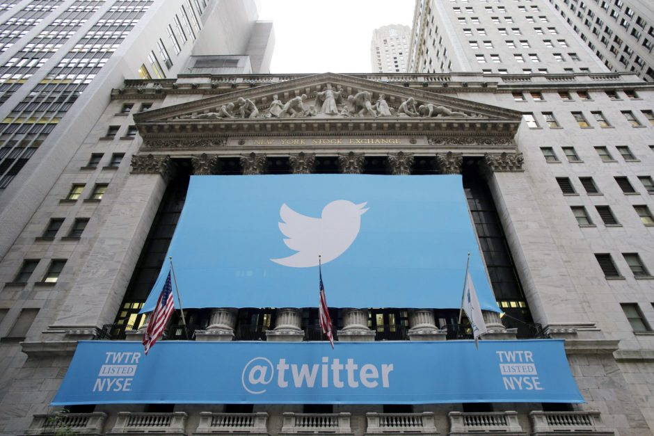 A banner with the Twitter logo hangs on the facade of the New York Stock Exchange in New York the day after the company went public, Nov. 7, 2013 .