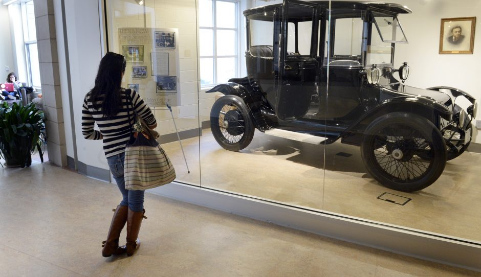 Union College student Shayna Han reads the information placard about Charles Steinmetz's 1914 Electric Car on display in the WOLD Center on campus on Wednesday.