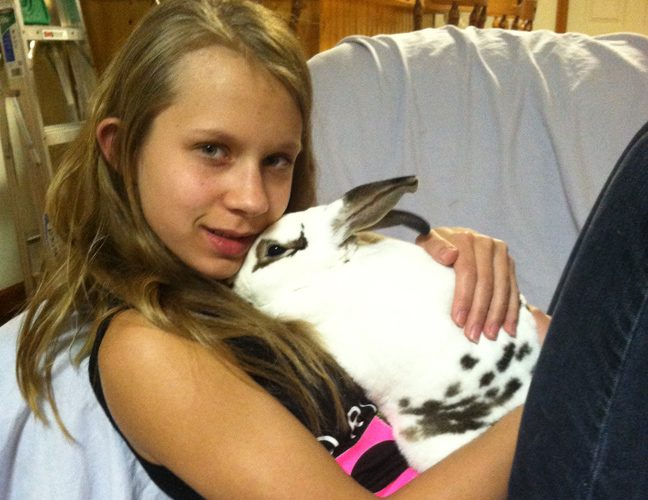 Jenna Chorny of Clifton Park holds Freckles, one of her two rabbits. (Photo supplied)