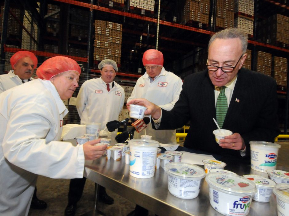 U.S. Senator Charles E. Schumer tastes yogurt at the Fage production plant in the Johnstown Industrial Park in January 2013.