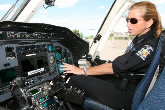 Technical Sgt. Kathy Sweeney shows some of the controls inside the cockpit of a Bell 430 twin-engine utility helicopter that is often used for MedEvac operations at the New York State Police Aviation Unit in Colonie Thursday afternoon.