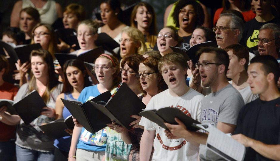The Scotia-Glenville Choralaires rehearse in the high school auditorium Wednesday.