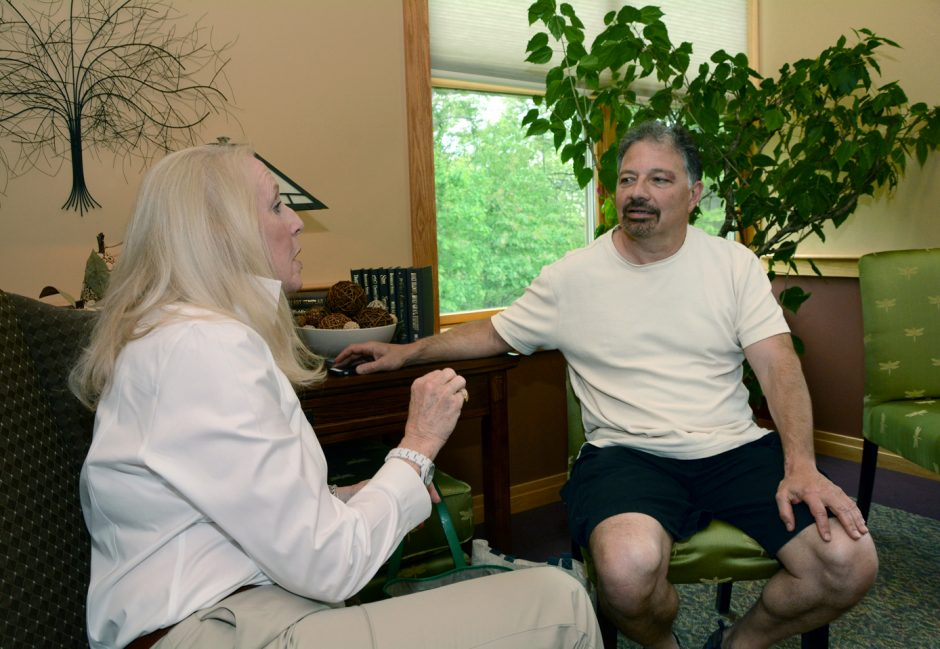 """Mountain Valley Hospice, Gloversville, volunteer Susan Hathaway-Ringland talks in private during """"Dignity Therapy"""" with John Papa, a family member of a hospice patient."""