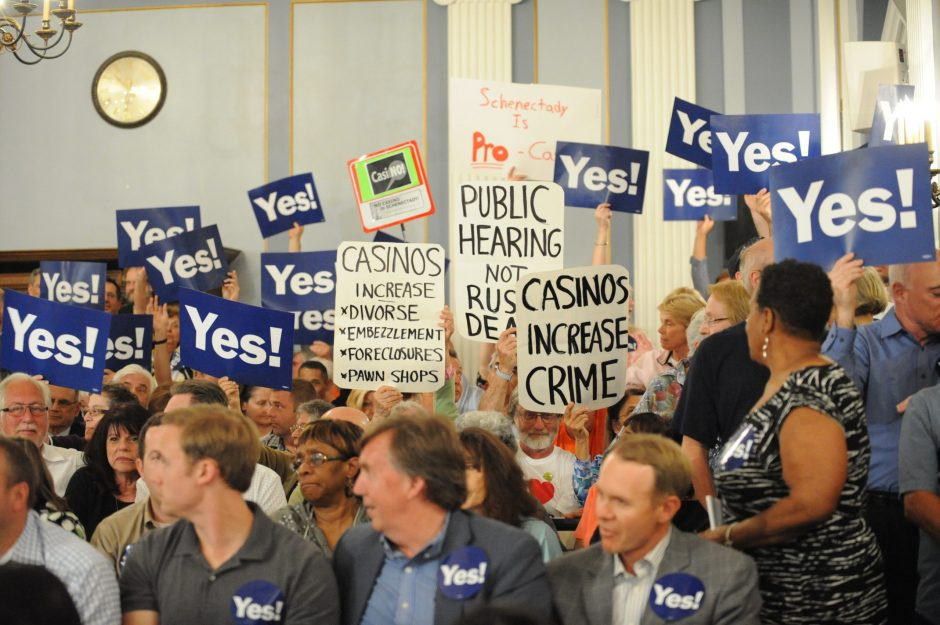 People carrying signs in favor of and opposed to the proposed Schenectady casino came out to the City Council meeting on Monday.