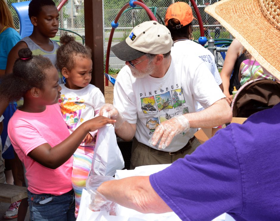 On Monday, the Schenectady Inner City Ministry (SICM) kicked off its free summer lunch program in the city. Here, volunteers Harvey and Mary Alexander ask kids which kind of sandwich they prefer.