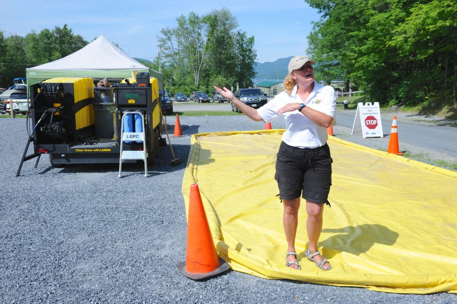 Shari Dufresne, site supervisor at the Norowal Marina boat inspection station on Lake George, explains the boat washing process in this July 2014 photo.