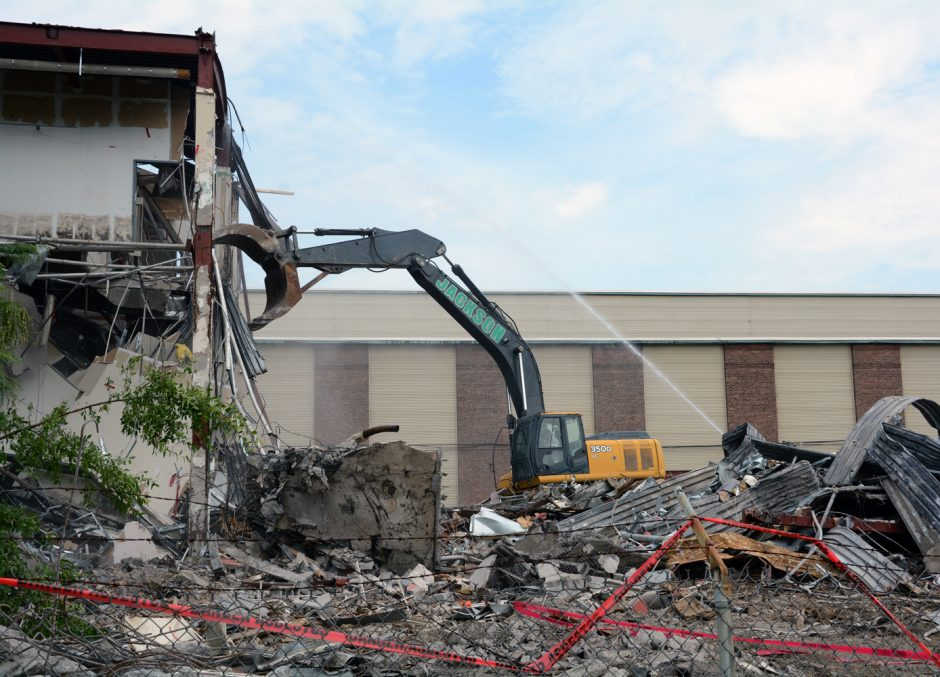 A crew from Jackson Demolition demolishes a building in the former Schenectady Business & Technology Park now owned by the Galesi Group at the corner of Front and Nott streets in Schenectady.