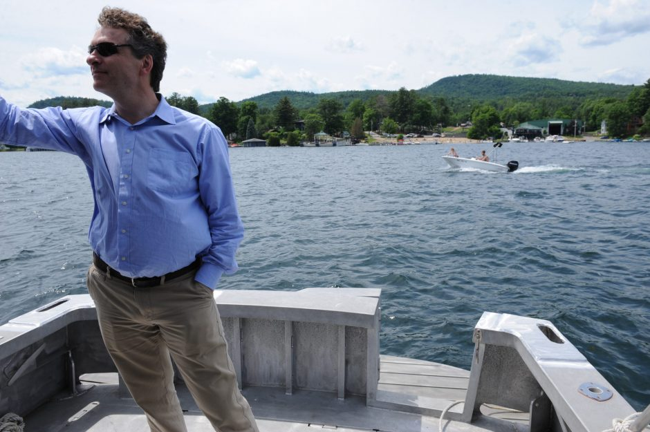 Eric Siy, executive director of the Fund For Lake George, looks out over the lake from aboard the Mintaka.