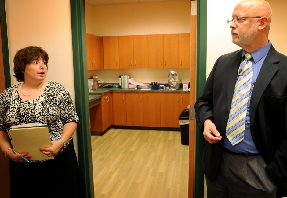 Linda Scharf director of communications for Planned Parenthood, left, and CEO Paul Drisgula, conduct a tour of the new facility on Route 30 in the KEM Plaza in Amsterdam Wednesday.