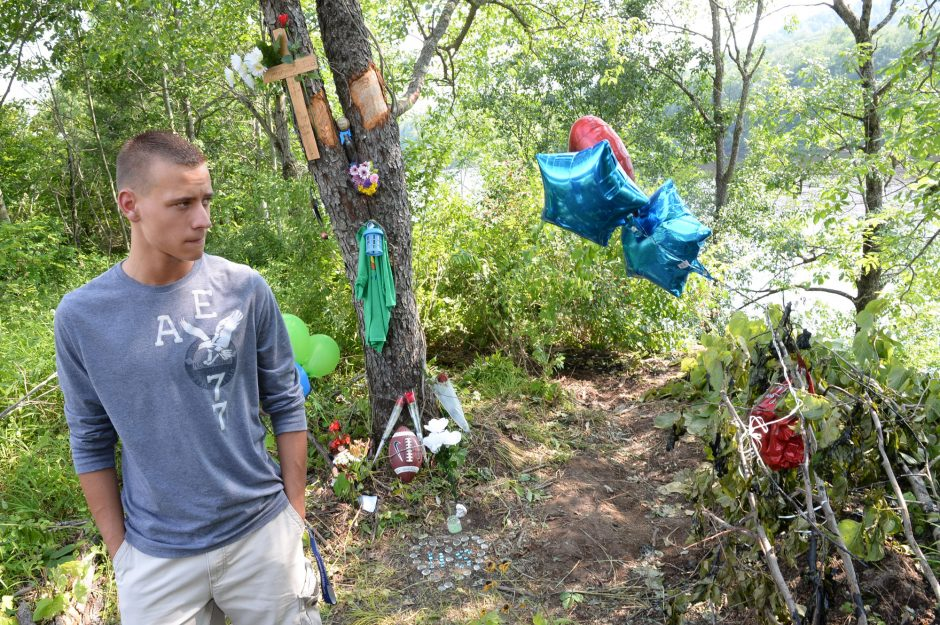 Chris Deuel, 17 years old, a friend of Hunter Scofield, at the roadside memorial where a Tubby Tubes water tubing tour bus overturned, killing 15 year old tour guide Hunter Scofield, as seen on Monday, July 7, 2014.