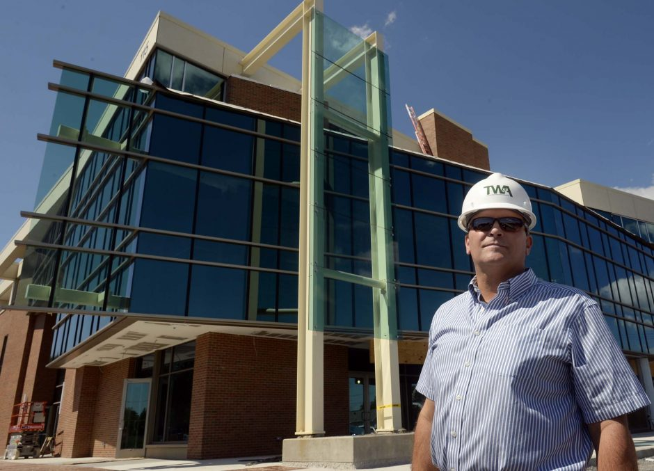 Bill Socha stands in front of the new Socha building at 115 Saratoga Road in Glenville on Friday, July 11, 2014.