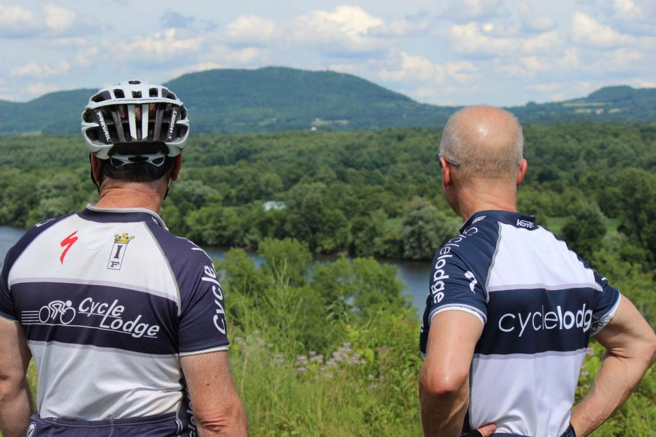 Bicyclists Mickey Ahearn of Marshfield, Mass., and Doug Ross of Duxbury, Mass., look out at the Hudson River while taking a break at The Great Redoubt, tour stop 9 at Saratoga Battlefield.