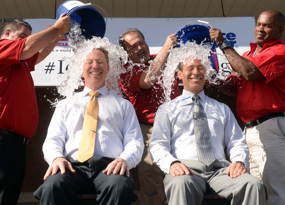 Price Chopper CEO Jerry Golub, left, and Senior Vice President David Golub, have buckets of ice water dumped on their heads by store managers Lou Walsh, left, Carlos DeSousa, and Wes Holloway as part of the ALS Ice Bucket Challenge at the Balltown Road...