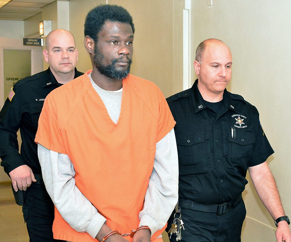 Schenectady County sheriff's deputies lead accused baby killer and rapist Herman Robinson from his arraignment in Schenectady County Court in March.