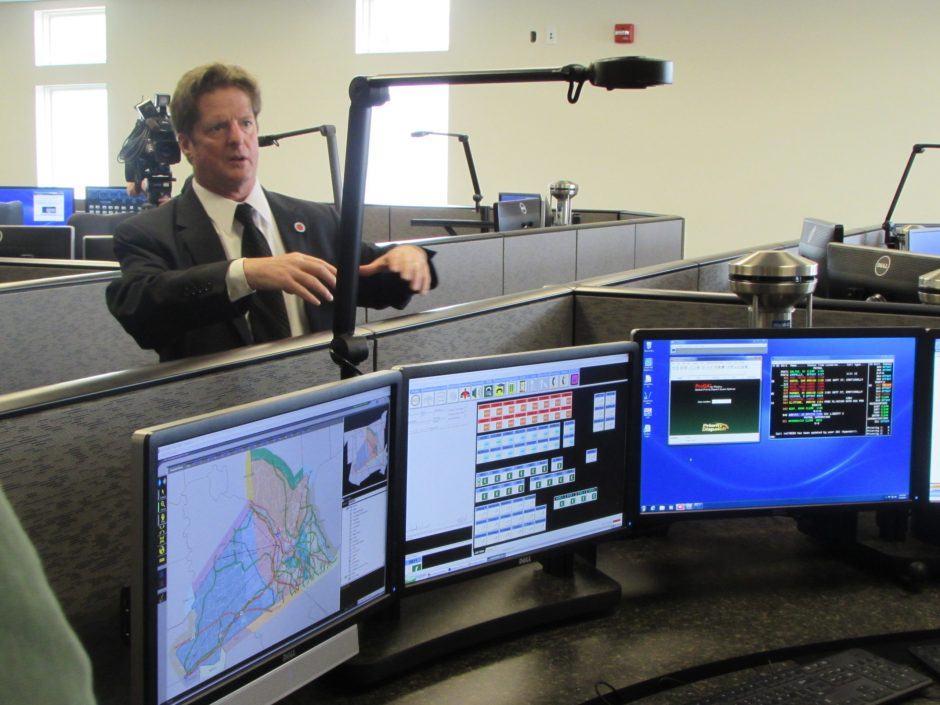 Jeffrey Cunningham, director of the Unified Communications Center, gives a tour of the county-wide dispatch center in Rotterdam in this May 15 photo.